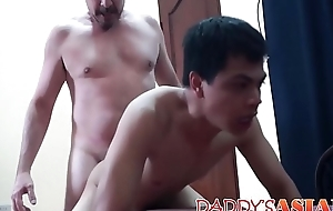 Little Asian twink bends over and takes it from behind