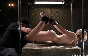 Slim sexy blonde shackled to the wall