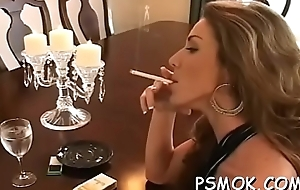 Charming babe sucks a dick like a pro while smokin'_ a cig