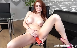 Luxurious red-haired MILF stuffs cunny with red toy