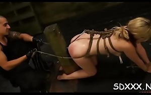 Tattoed bitch in ropes gets disciplined in sadomasochism session